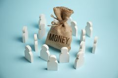 Figures of people are drawn to bag of money and wealth royalty free stock photography