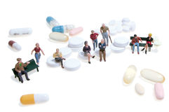 Figures and pills Royalty Free Stock Photography