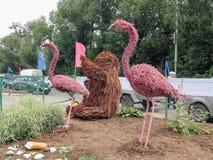 Figures of pink flamingos Stock Photos