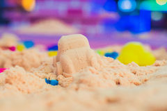 Figures from the pink kinetic sand The development of fine motor concept. Creativity Game concept Royalty Free Stock Photos