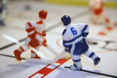 Figures of players active in Board game. Macro photo of a red and blue Figures hockey players of the opposing teams in the active table retro game of hockey Stock Photo