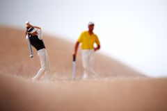 Figures Playing Golf On Naked Woman Body Royalty Free Stock Photos