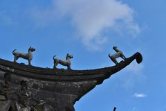 Figures on a roof, Shanghai Stock Photo