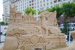 Figures from the sand Griffins, castle, monkey barrels, cypress trees. Moscow Royalty Free Stock Image