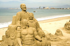 Figures Sculpted In Sand Stock Photos