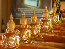 Figures of the sitting Buddha in the Wat Saket Temple or Golden mount, Bangkok, Thailand Royalty Free Stock Image