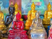 Figures of the sitting Buddha in the Wat Saket Temple or Golden mount, Bangkok, Thailand Stock Photos