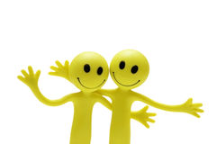 Figures of smilies hugging Stock Images