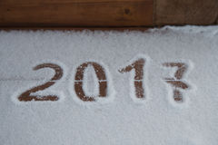 Figures 2017 on the snow. New year and christmas theme.  Stock Image