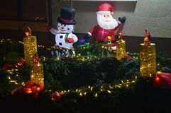 Figures snow white and santa claus and the fourth advent candle in the bistarac royalty free stock photo