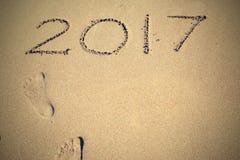 Figures sur le sable 2017 et les traces Photographie stock