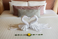 The figures of swans sleeping on bed Stock Images