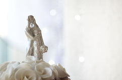 Figures on wedding cake. Marzipan figure of married couple on wedding cake stock image