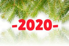 Figures 2020 on a white background, frame of fir branches stock photo