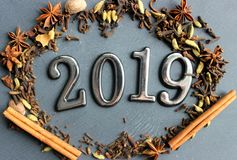 Figures 2019 on a wooden vintage background surrounded by fragrant spices for mulled wine. royalty free stock photography