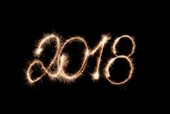 2018 - figures written by sparkler lights. On a black background Royalty Free Stock Photo