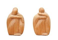 Figurilla de dos africanos hecha de la madera Imagen de archivo libre de regalías