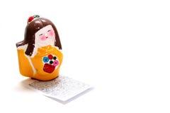 Figurilla pintada del geisha Foto de archivo