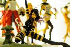 Figurina della ragazza di potere del furfante Fotografia Stock Libera da Diritti