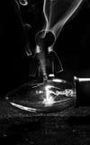 Figurina su una lampadina Fotografie Stock Libere da Diritti