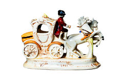 Figurine – Man on coach harnessed with two horses. Isolated royalty free stock photography