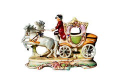 Figurine – Man on coach harnessed with two horses. Isolated stock photos