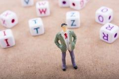 Figurine и красочные кубы письма алфавита Стоковая Фотография RF
