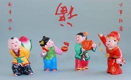 Figurine_all fortunato cinese dell'argilla il la cosa migliore (salmerino) Fotografie Stock Libere da Diritti