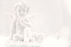 Figurine of an angel in blurred background Royalty Free Stock Image