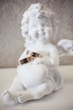 Figurine of an angel with rings Royalty Free Stock Image