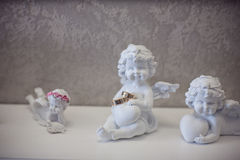 Figurine of an angel with rings Stock Photography