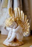 Angel. Figurine angel white standing on the surface on occasion Stock Image