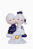 Figurine of boy and girl  sitting on a tree stump Royalty Free Stock Photography