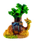 Figurine - Camel under the palm trees in the tropics Stock Photography