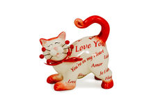 Figurine a cat with inscriptions about love. Gift cat statuette with the words Love you isolated on a white background Royalty Free Stock Photos