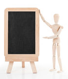 Figurine and chalkboard Royalty Free Stock Photos