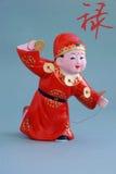 Figurine chanceuse chinoise d'argile - riches (char) Image libre de droits