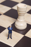 Figurine and chess Stock Photos