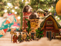 The figurine. Christmas figurine with the background of gift boxes Royalty Free Stock Photo