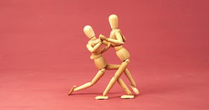 Figurine couple dancing. Against pink background 4k stock video footage