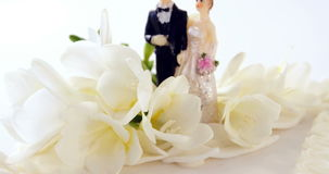 Figurine couple decorated with flowers stock video footage