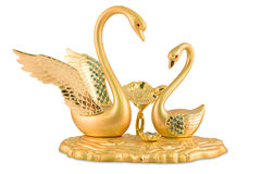Figurine d'or de cygnes de couples Photographie stock