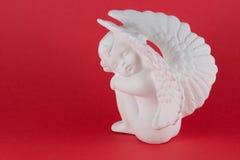 Figurine de assento do anjo Fotografia de Stock