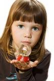 Figurine de Papai Noel da preensão da menina Imagens de Stock Royalty Free