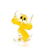 Figurine de vidro amarelo do gato fotografia de stock royalty free