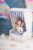 Figurine in doll furniture - holiday, summer or beach concept Stock Image