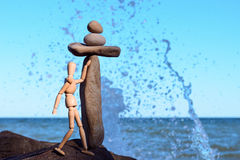 Figurine of dummy at seashore. Figurine of dummy stands at the seashore Royalty Free Stock Photography