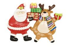 Figurine e Rudolph de Santa a rena com o nariz vermelho Fotografia de Stock Royalty Free