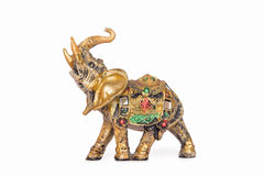 Figurine of an elephant. A figurine of an indian elephant decorated with pieces of mirror, isolated on white background Royalty Free Stock Photo