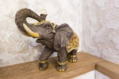 A figurine of an elephant on a shelf luck, happiness in the house Royalty Free Stock Photography